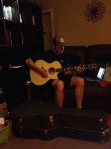 """My husband, strumming away on his guitar. Being able to play the guitar was one of the items on my """"it would be nice if my future husband..."""" list. I love when he plays!"""